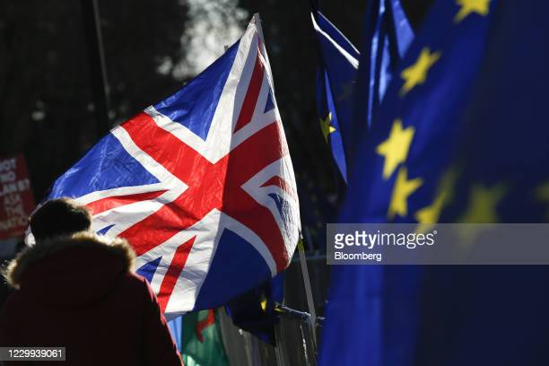 British Union flag, also known as a Union Jack, flies beside European Union flags during ongoing pro and anti Brexit protests outside the Houses of...