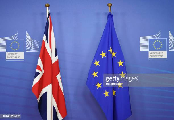 A British Union flag also known as the Union Jack left and a European Union flag hang ahead of the arrival of UK Prime Minister Theresa May in...