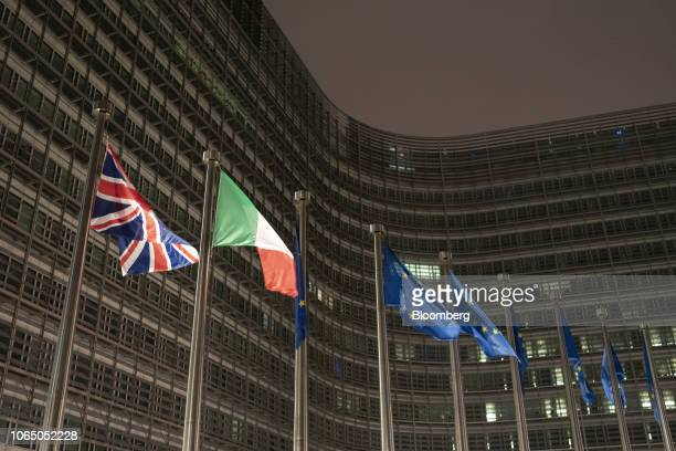 A British Union flag also known as the Union Jack left flies beside an Italian national flag second left and European Union flags outside the...