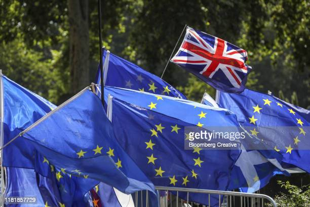 british union flag and european flag - pole stock pictures, royalty-free photos & images