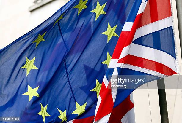 A British Union flag commonly known as a Union Jack right flies next to a European Union flag in London UK on Wednesday Feb 17 2016 German Chancellor...