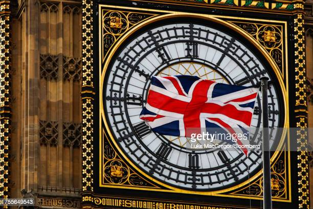 a british union flag flies beside big ben, in london.  - big mac stock pictures, royalty-free photos & images