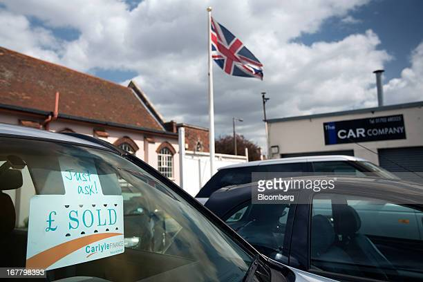 A British Union flag flies from a flagpole on the forecourt of an independent secondhand car dealership in LeighonSea UK on Monday April 29 2013...