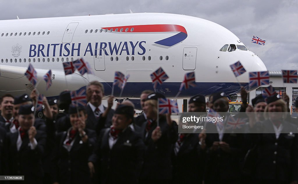 A British Union flag flies from the cockpit of a new Airbus A380 aircraft operated by British Airways (BA) after landing at Heathrow airport in London, U.K., on Thursday, July 4, 2013. British Airways will start regular services with the Airbus SAS A380 superjumbo a week earlier than planned after taking delivery of the first of 12 of the doubledeckers today. Photographer: Chris Ratcliffe/Bloomberg via Getty Images