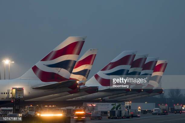 British Union flag logos sit on the tail fins of passenger aircraft operated by British Airways a unit of International Consolidated Airlines Group...
