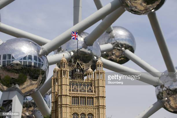 A British Union flag sits on top of a scale model of the British Houses of Parliament as the Atomium is seen behind at the Mini Europe theme park in...