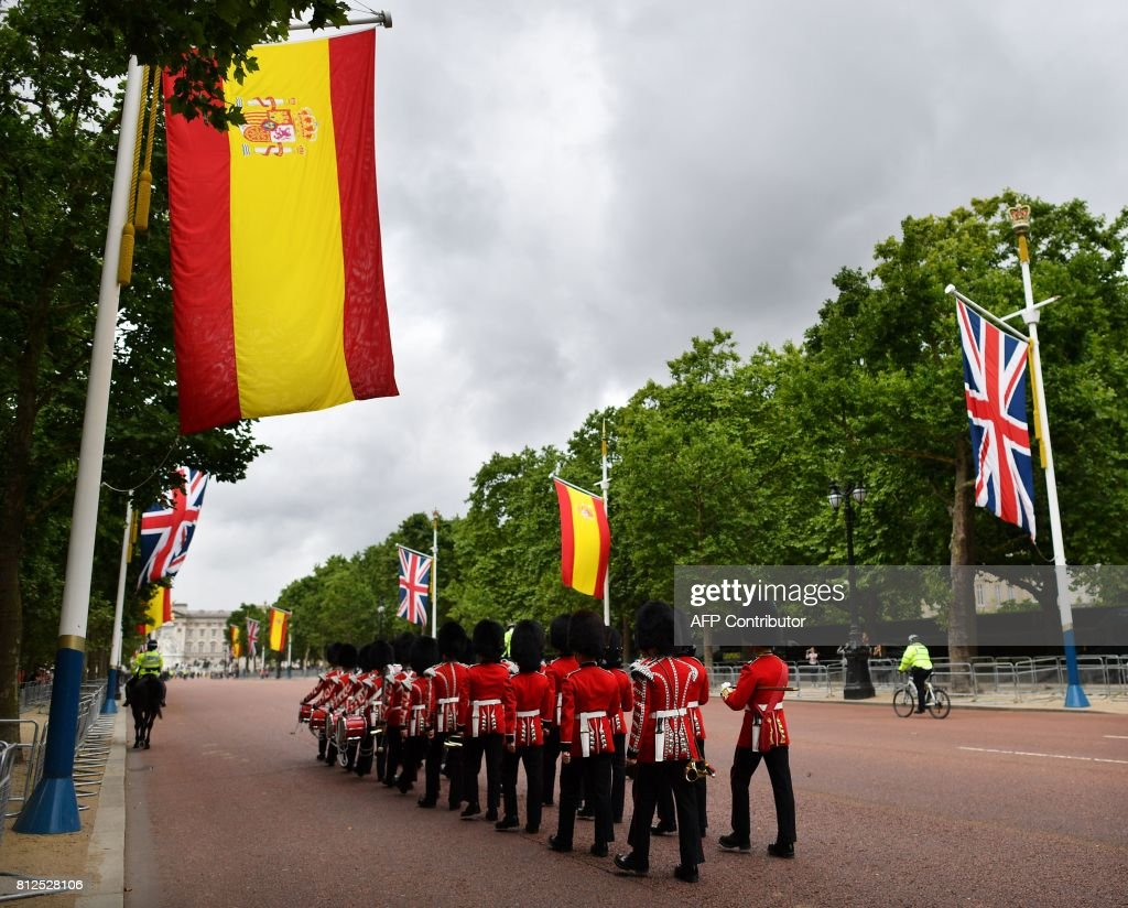 British Union flags and Spanish flags fly together on the Mall as preparations are underway in central London, on July 11, 2017, for of the state visit of Spanish King Felipe VI and Queen Letizia. Spanish King Felipe VI and Queen Letizia begin a state visit to Britain on Wednesday, as the two countries attempt to strengthen ties despite tensions over Britain's plans to leave the European Union. /