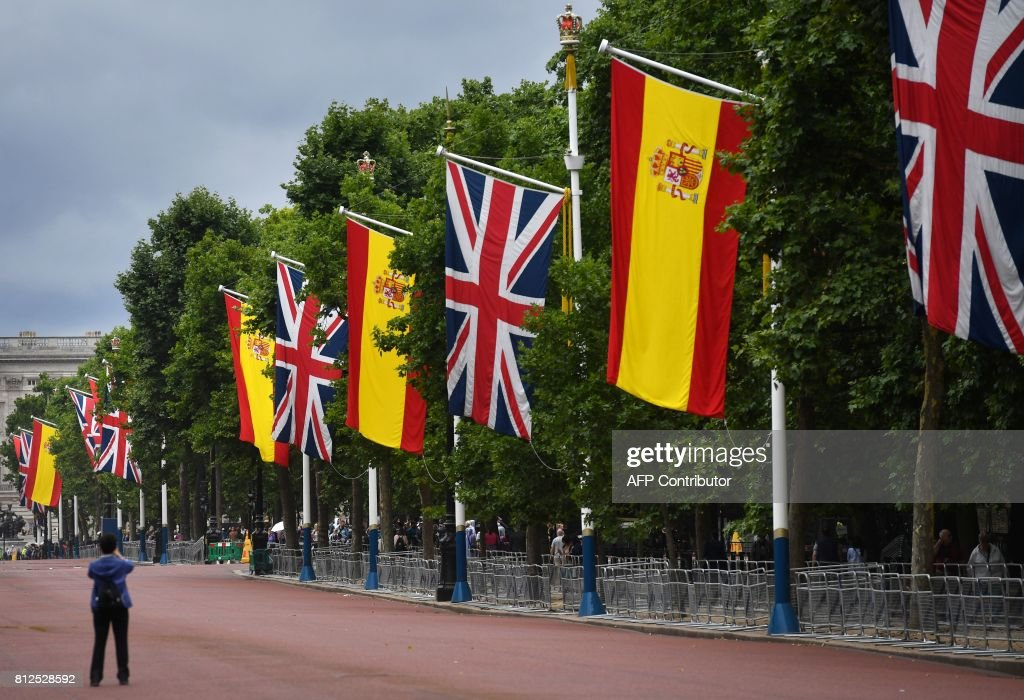 British Union flags and Spanish flags fly together on the Mall in central London, on July 11, 2017, as preparations are made for of the state visit of Spanish King Felipe VI and Queen Letizia. Spanish King Felipe VI and Queen Letizia begin a state visit to Britain on Wednesday, as the two countries attempt to strengthen ties despite tensions over Britain's plans to leave the European Union. /
