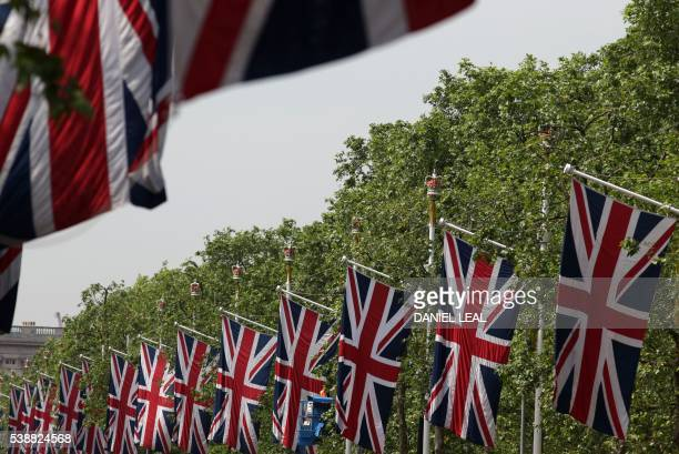 British Union flags hang above The Mall in central London on June 8 as Britain prepares to celebrate the 90th birthday of Queen Elizabeth II Events...