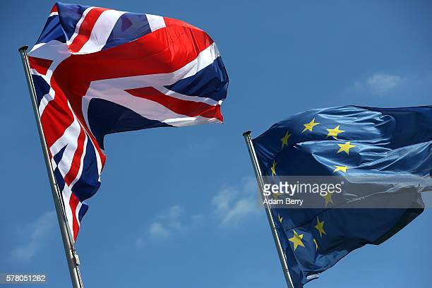 British Union Jack and European Union flag fly as Theresa May Prime Minister of the United Kingdom visits German Chancellor Angela Merkel on July 20...