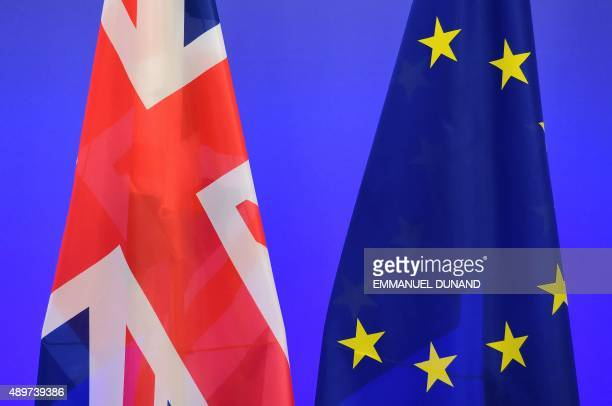 A British Union Jack flag and a European Union flags are seen ahead of a meeting between British Prime Minister and European Council President at the...