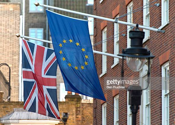 British union jack flag and the European europa flag fly outside the former conservative party central office on February 19 2016 in London England...