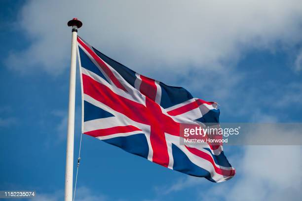 British Union Jack flag flying against a blue sky on May 27 2019 in Cardiff United Kingdom