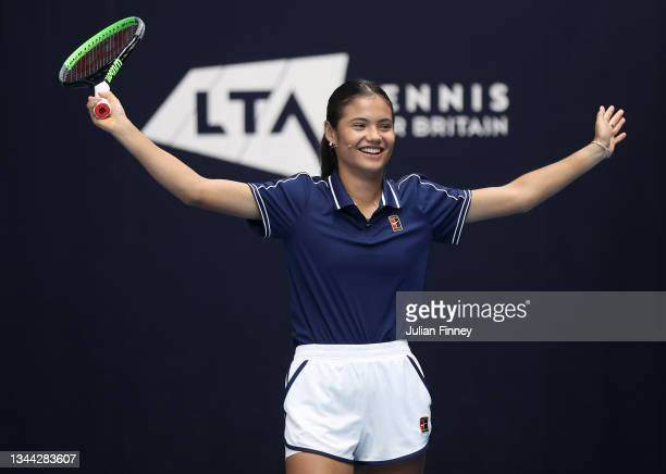 British US Open champion Emma Raducanu celebrates returning her own US Open Final match point serve as she returns to the LTA's National Tennis...