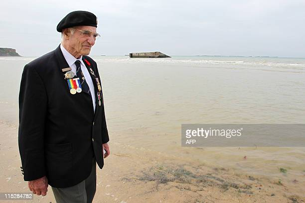 British veteran Gordon Smith walks on June 6 2011 on the beach of ArromancheslesBains northwestern France during a ceremony to mark the 67th DDay...
