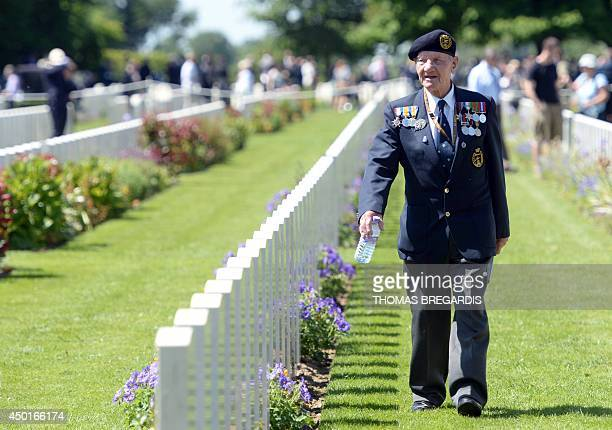 A British veteran walks in the British War Cemetery of Bayeux on June 6 after a binational FranceUK DDay commemoration ceremony marking the 70th...