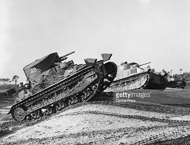 British Vickers Medium Mark II tanks of The Royal Armoured Corps driving cross country during tests on a tank proving ground at Bovington Camp in...