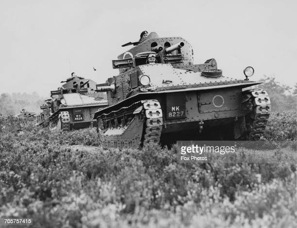British Vickers Medium Mark II tanks of The Royal Armoured Corps driving cross country during maneuvers on a tank proving ground at Bovington Camp in...