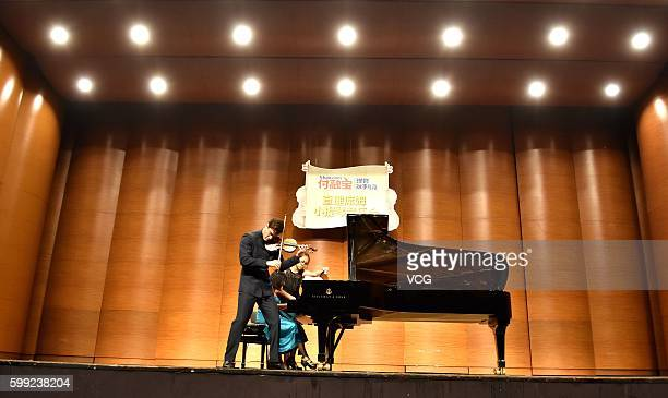 British violinist Charlie Siem performs onstage in his national tour on September 3 2016 in Nanjing Jiangsu Province of China