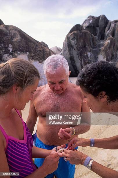 British Virgin Island, Virgin Gorda, The Baths, Naturalist SUSAN Adie Explaining Shells.