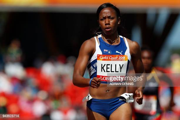 British Virgin Islands' Ashley Kelly competes in the athletics women's 400m heats during the 2018 Gold Coast Commonwealth Games at the Carrara...