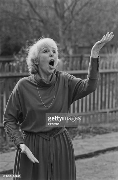 British vocal coach Tona deBrett gesturing with her hands as she reaches the high notes, United Kingdom, 8th March 1985.