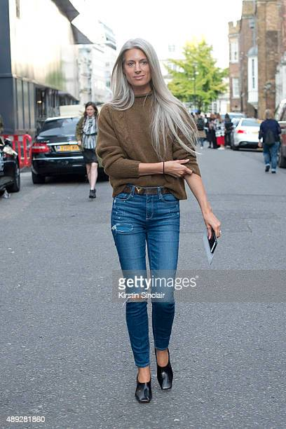British Vogue Fashion features Editor Sarah Harris wears Margaret Howell sweater Paige jeans and Louis Vuitton belt on day 2 during London Fashion...