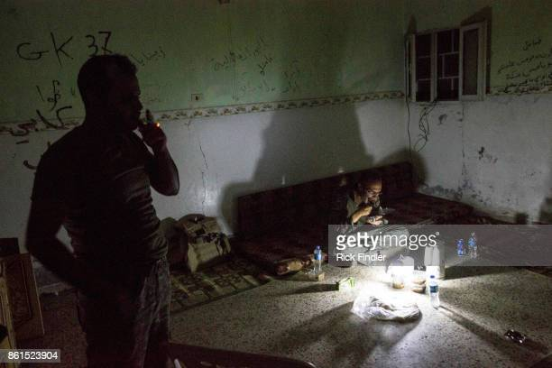 British volunteer fighter 'Macer Gifford' eats dinner on the floor of his nocter on the front lines on August 18 2017 in Raqqa Syria Five years ago...