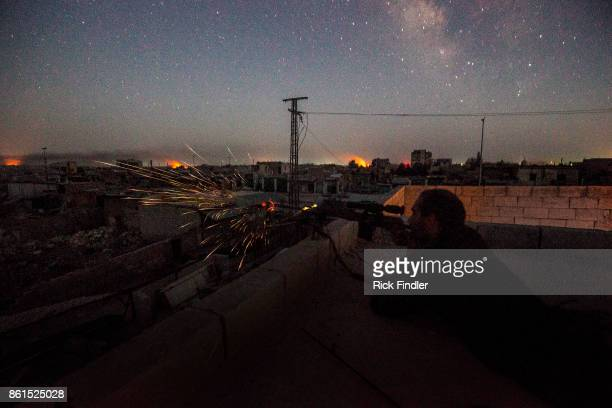 British volunteer fighter 'Macer Gifford' shoots his sniper rifle at ISIS positions in the late hours of the evening on August 18 2017 in Raqqa Five...