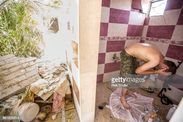 British volunteer fighter 'Macer Gifford' washes in an abandoned house on the front line on August 17 2017 in Raqqa Five years ago 'Macer Gifford'...