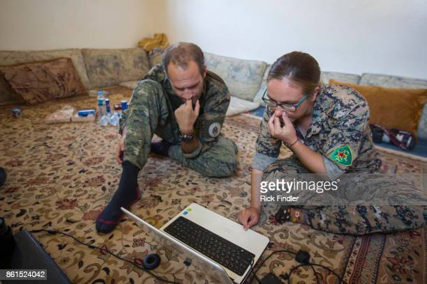 British volunteer fighters 'Macer Gifford' and 'Zilan' both from the UK sit in disbelief as they read a BBC article stating that any foreign...