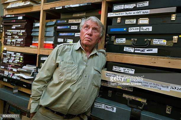 British war photographer Don McCullin with boxes of his photographs stored in the print room at his home in Somerset 21st July 2015