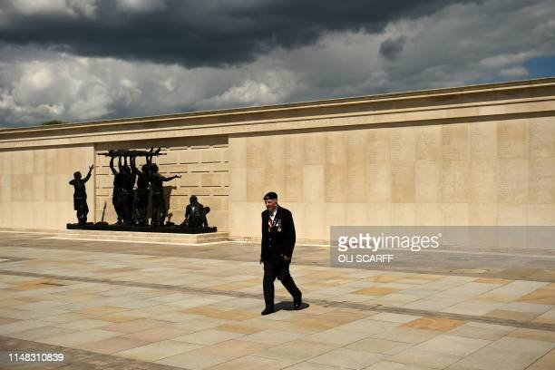 A British war veteran looks at the names enscribed on the memorial after attending the service at the National Memorial Arboretum in Alrewas...