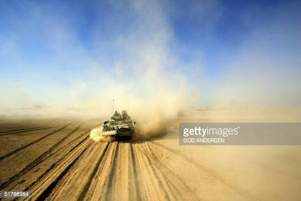 British Warrior from the Black watch regiment manouvers the sand in the British forward base of Al Quaqa near the Iraqi city of Yusufiyah south of...