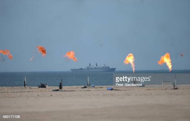 British warship HMS Bulwark sits off the Normady coastline during the stage show at the International Ceremony at Sword Beach to commemorate the 70th...