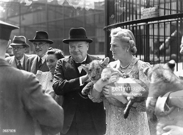 British wartime prime minister Winston Churchill with his wife Clementine holding a lion cub during a trip to London Zoo