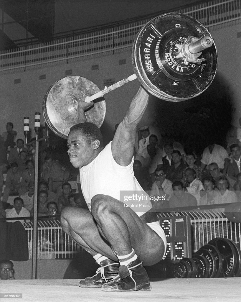 British weightlifter Louis Martin competing in the Middle Heavyweight event at the Rome Olympics, 12th September 1960. Martin eventually won the bronze medal.
