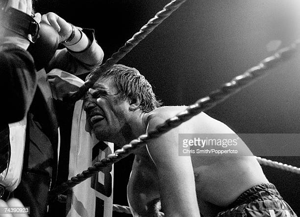 British welterweight boxer Colin Jones falls into the corner of the ring bleeding heavily from a cut nose as his World Welterweight Championship...
