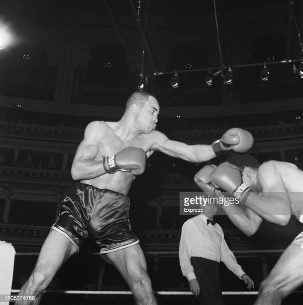 British welterweight boxer Lloyd Honeyghan throws a punch as American boxer Roger Stafford bobs and weaves to avoid the blow at the Royal Albert Hall...