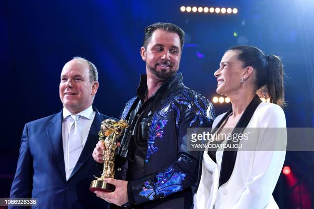 British wild cat trainer Martin Lacey Junior receives a gold clown awards from Prince Albert II of Monaco and Princess Stephanie de Monaco during the...