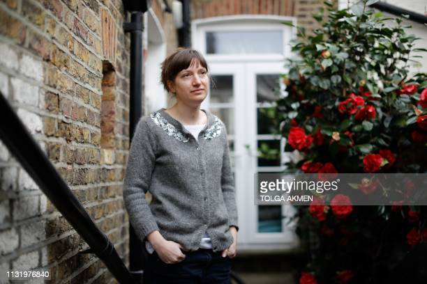 British woman Amy Pollard poses at her home during an interview with AFP in London on March 22, 2019. - Pollard, who had previously been diagnosed...