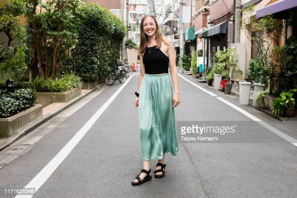 british woman smiling on the streets of tokyo - open toe stock pictures, royalty-free photos & images