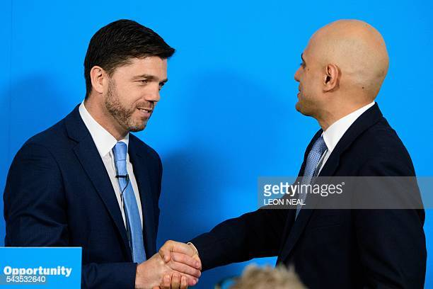 British Work and Pensions Secretary and Conservative MP Stephen Crabb shakes hands with British Business Secretary Sajid Javid following a news...