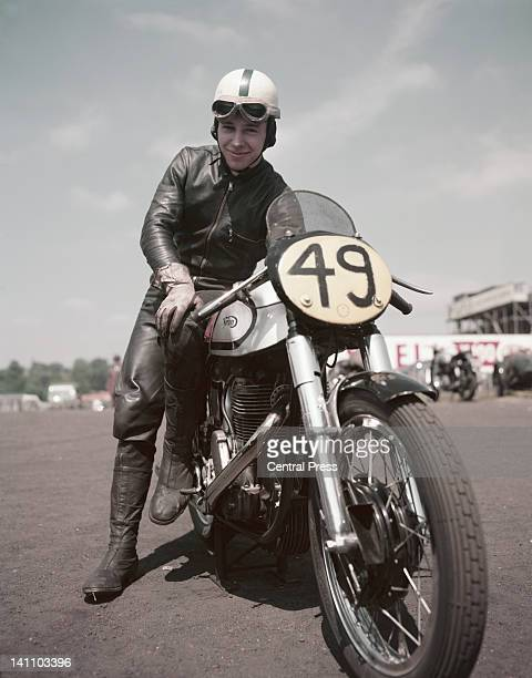 British world champion motorcyclist and racing driver John Surtees sits astride the 500cc Manx Norton during International Motorcycle races on 9th...