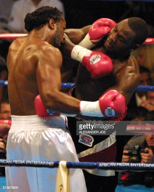 British World Heavyweight champion Lennox Lewis and US challenger Hasim Rahman during their fight, 21 April 2001 at the Carnival Areana in Brakpan,...