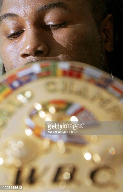 British world heavyweight champion Lennox Lewis with his WBC title announces his retirement from boxing during a press conference at Grosvenor House...