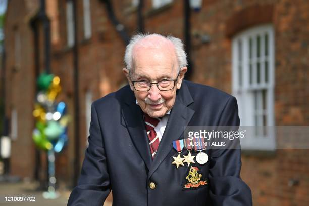 British World War II veteran Captain Tom Moore poses doing a lap of his garden in the village of Marston Moretaine 50 miles north of London on April...
