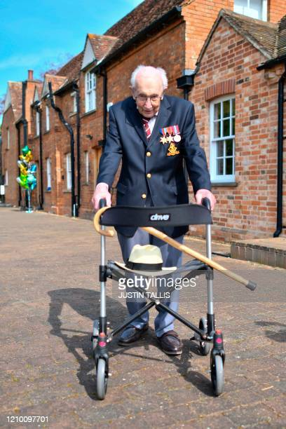 British World War II veteran Captain Tom Moore poses with his walking frame doing a lap of his garden in the village of Marston Moretaine 50 miles...