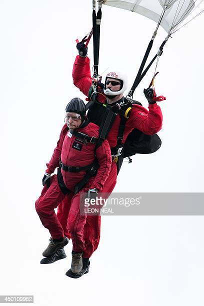 British World War II veteran Jock Hutton performs a successful tandem jump with a British 'Red Devils' paratroopers as they and teams of French US...
