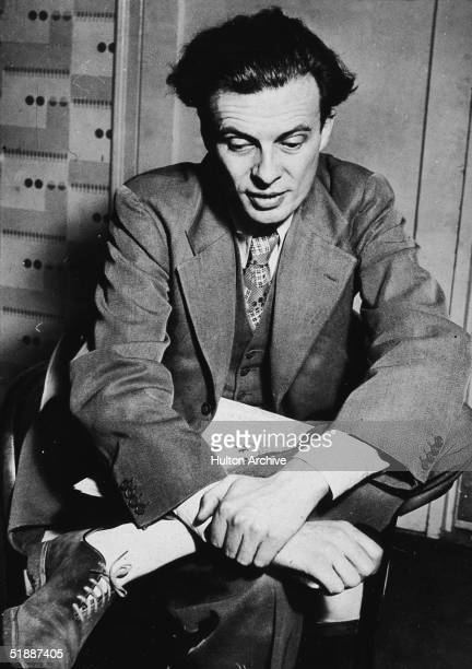 British writer Aldous Huxley sits with a newspaper on his lap 1930s